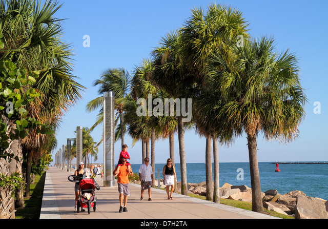Miami Beach Florida South Pointe Park Government Cut Biscayne Bay Atlantic Ocean man woman couple father mother - Stock Image