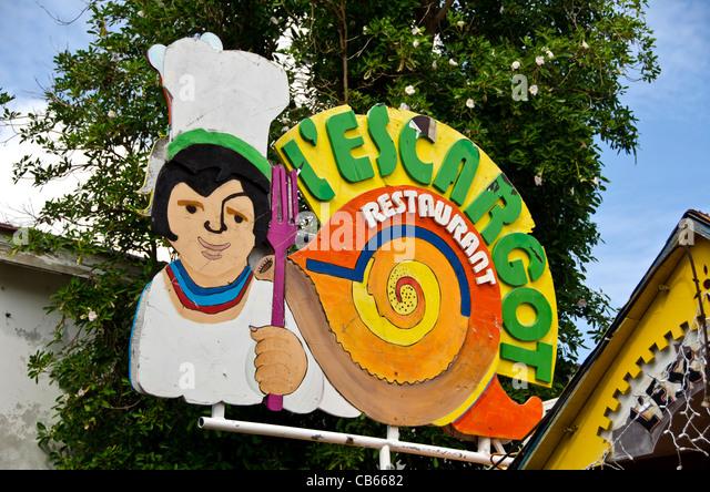 St Maarten L'Escargot Restaurant sign on Front Street Philipsburg - Stock Image