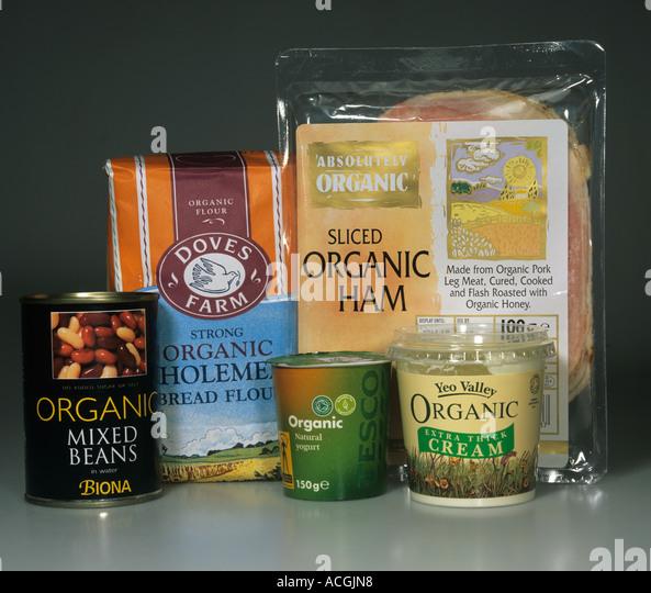 Selection of organic produce including cream yogurt flour ham beans - Stock Image