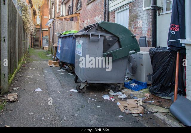 Unsightly Overflowing Rubbish Wheelie Bin - Stock Image