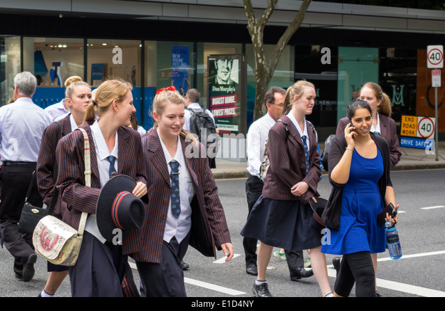 Brisbane Australia Queensland Central Business District CBD Adelaide Street student teen girl friends crossing walking - Stock Image