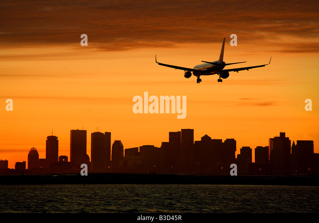 Silhouette of aircraft and cityscape - Stock Image