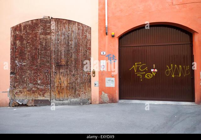 Two contrasting wooden garage doors. - Stock Image