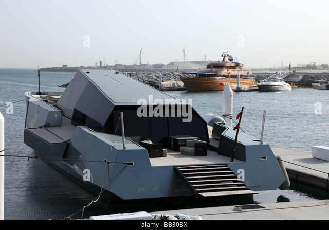 minimalist yacht out of London moored in the Jumeirah Marina Dubai United Arab Emirates - Stock Image