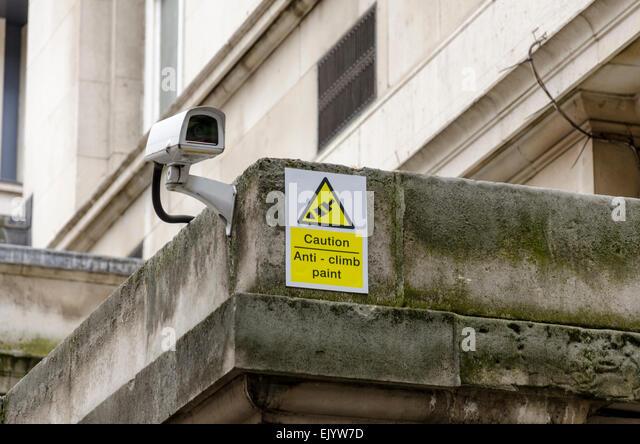 Anti climb paint sign and CCTV camera, London, UK - Stock Image