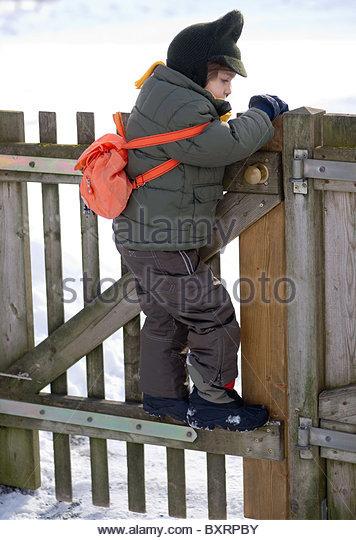 Child Climbing The Fence Stock Photos Amp Child Climbing The