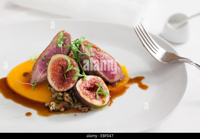 Duck and fig entree in high end resturant - Stock Image