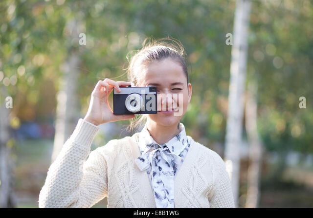 young boy shooting girls with camera phone