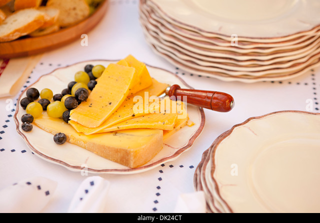 Cheese plate with blueberries and grapes - Stock Image