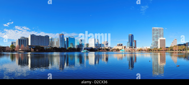 Orlando Lake Eola in the morning with urban skyscrapers and clear blue sky. - Stock Image