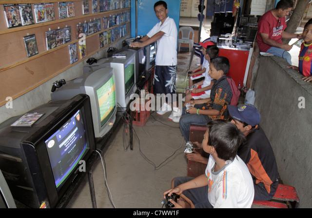 Managua Nicaragua Mercado Roberto Huembes market marketplace shopping video game console game gamer arcade business - Stock Image
