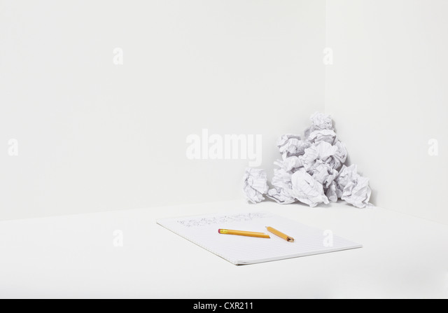 Broken pencil, notebook and crumpled paper - Stock Image