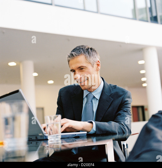 View of business man viewing laptop License free except ads and billboards - Stock Image