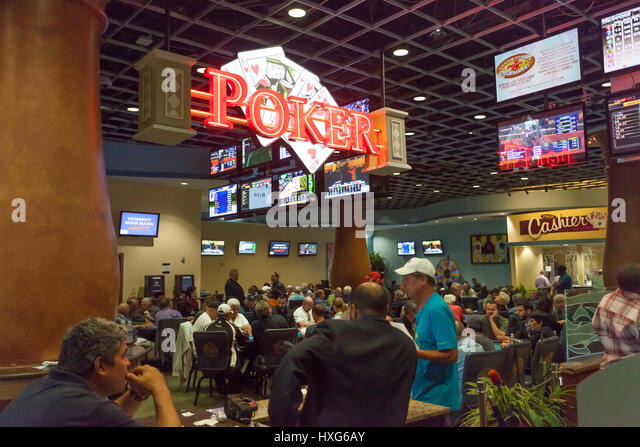 HALLANDALE BEACH, USA - MAR 11, 2017: People  gambling in the Gulfstream park casino in Hallandale Beach. Florida, - Stock Image