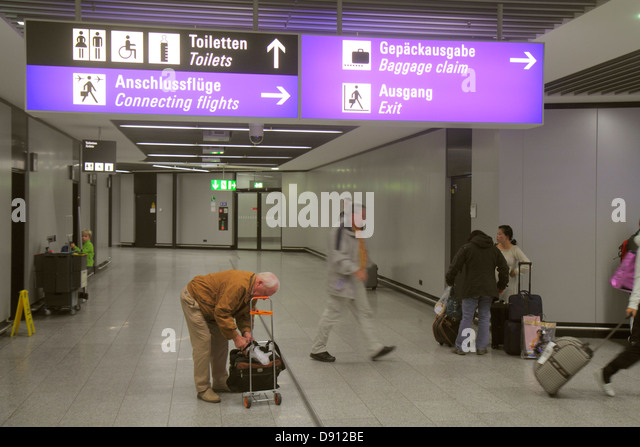 Germany Frankfurt am Main Airport FRA terminal gate area concourse sign German language arriving passengers connecting - Stock Image