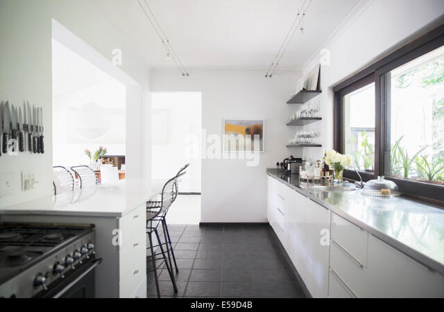 Counters and breakfast bar in modern kitchen - Stock Image