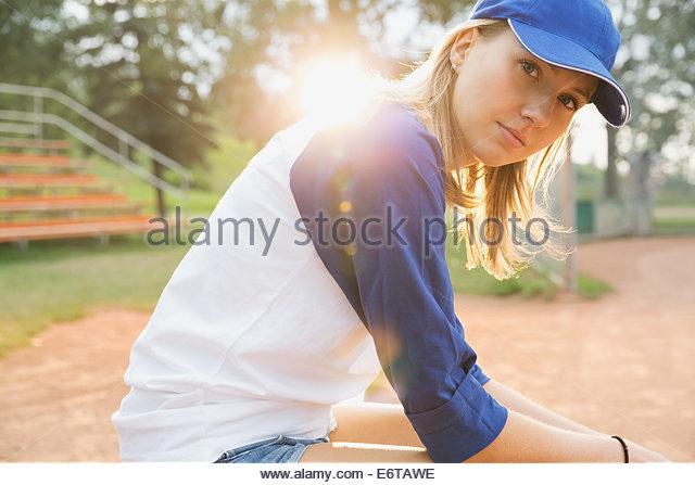 Baseball player sitting on field - Stock Image
