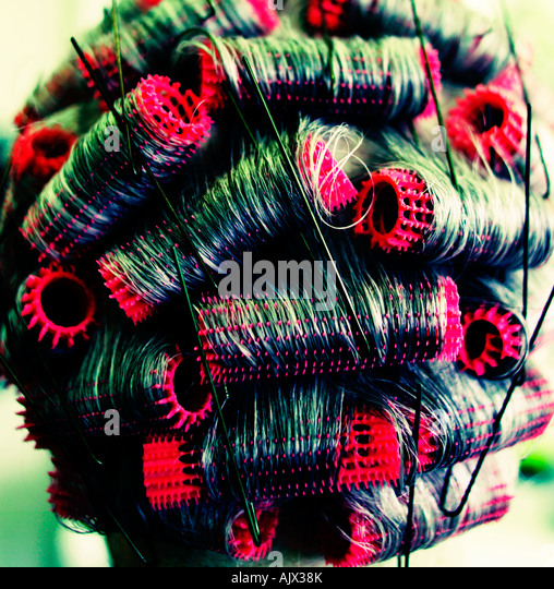 Abstract of curlers at the hairdressers - Stock-Bilder