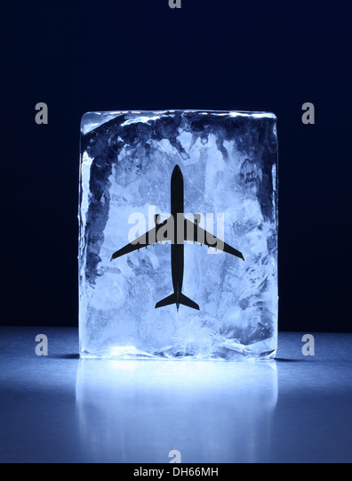 A model airplane frozen in a clear block of ice - Stock Image