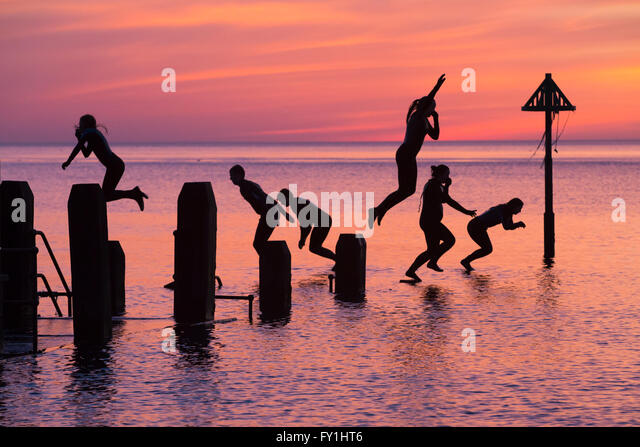 Aberystwyth, Wales, UK. 20 April 2016. At the end of a glorious spring day, a group of young people continue tyo - Stock Image