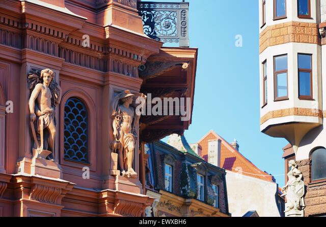 Beautiful sculptures and bas-reliefs on the facades of ancient and medieval buildings in Riga - Stock Image