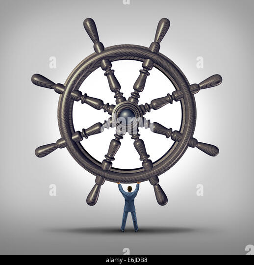 Take the reins and change course business concept as a businessman holding a ship wheel steering gear as a symbol - Stock Image