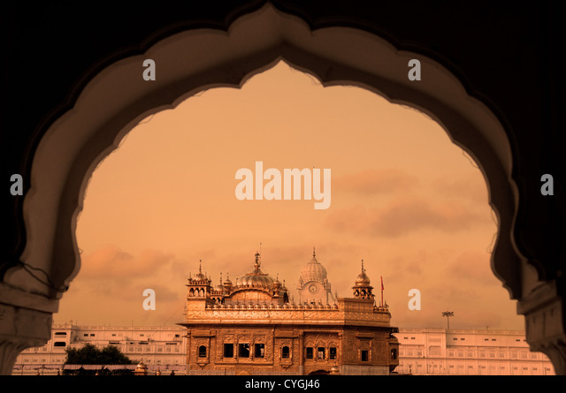 The Golden Temple of Amritsar - India. Framed with windows from west side. focus on temple - Stock-Bilder