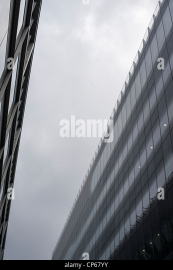 Modern glass buildings in Bread Street London UK. On an overcast day with monochrome patterns. - Stock Image