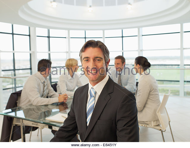 Business people meeting in conference room - Stock Image