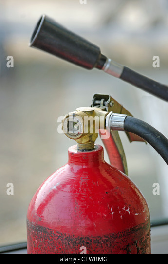 carbon dioxide fire extinguisher, and a funnel with a tube for gas - Stock Image