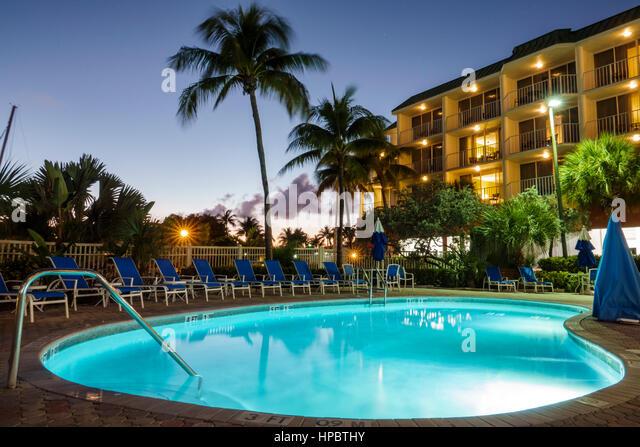 Key Largo Florida Upper Florida Keys Courtyard Key Largo hotel swimming pool lighting night balconies - Stock Image