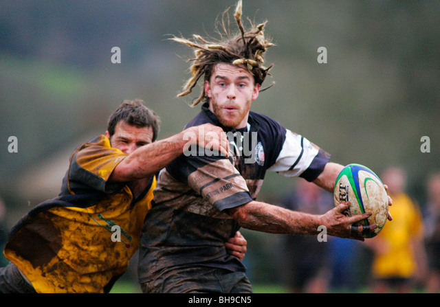 Rugby tackle during a match. - Stock Image