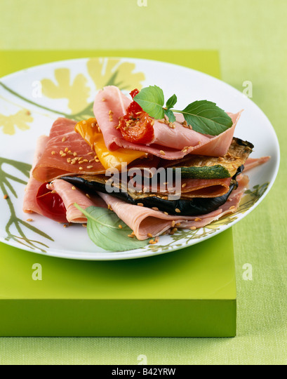 ham and grilled vegetable layer - Stock Image