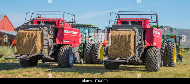 Agriculture, Farm Machinery, Big Tractors and Bailers parked at Rice Farms ready for harvest. Camas Prairie-Fairfield, - Stock Image