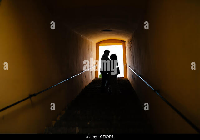 Silhouette of a couple in love hugging - Stock Image