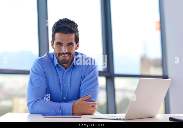 happy young business man at office - Stock Image