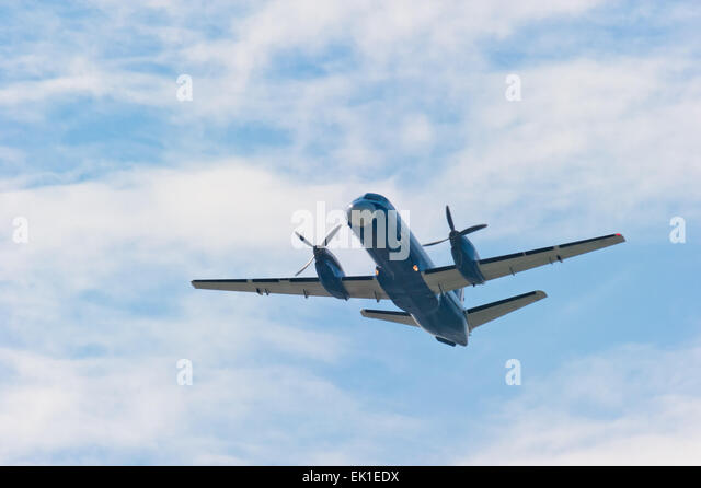 plane with propeller soars into the sky - Stock Image