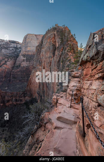 Trail and Chains Clinging to the Edge of Angels Landing Trail in Zion - Stock Image
