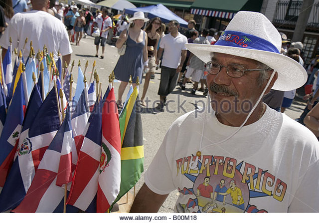 celebration man Puerto Rico tee shirt Latin American flags vendor - Stock Image