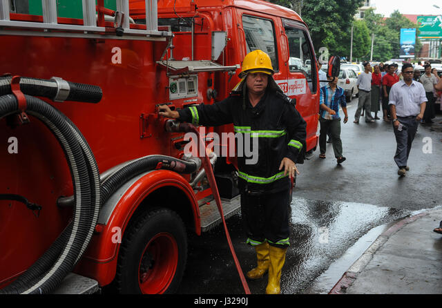 30.07.2013, Yangon, Republic of the Union of Myanmar, Asia - A fire fighter during an emergency operation in the - Stock Image