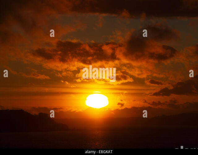 USA, Washington State, King County, Seattle, Sunset over land - Stock Image
