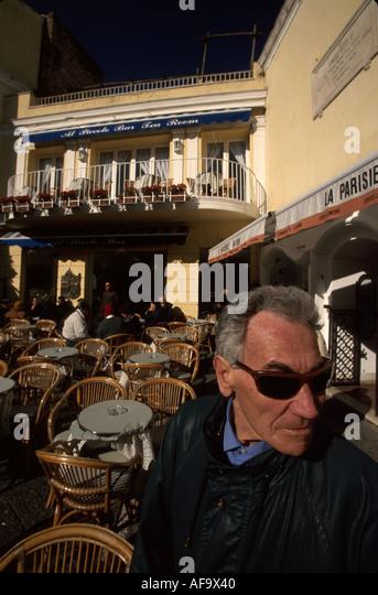 Italy Isle of Capri Tyrrhenian Sea Capri Town Piazza Umberto I Via Longano male resident - Stock Image