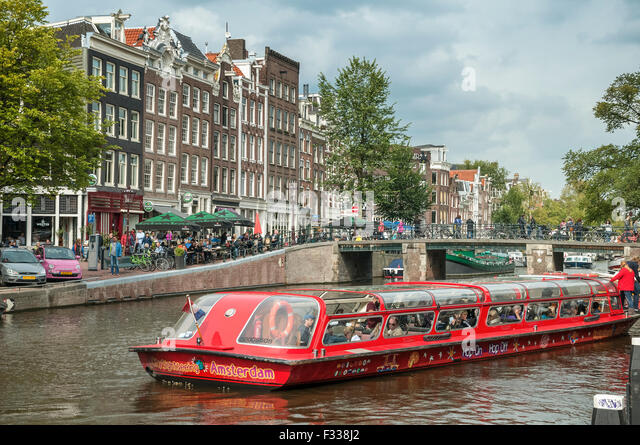 Pleasure boats on the canals of Amsterdam Holland. Netherlands - Stock Image