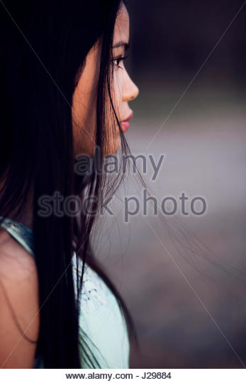 Portrait of a brunette young woman - Stock Image