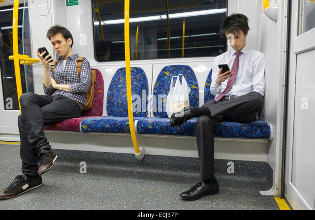 Sydney Australia NSW New South Wales Trains City Circle public transportation onboard cabin riders passengers Asian - Stock Image
