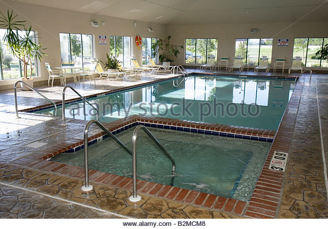 Wisconsin Kenosha Holiday Inn Express indoor swimming pool Jacuzzi lounge chairs - Stock Image