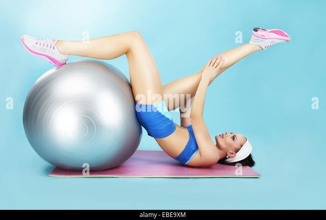 Wellness Concept. Woman in Sportswear with Sport Equipment - Stock Image