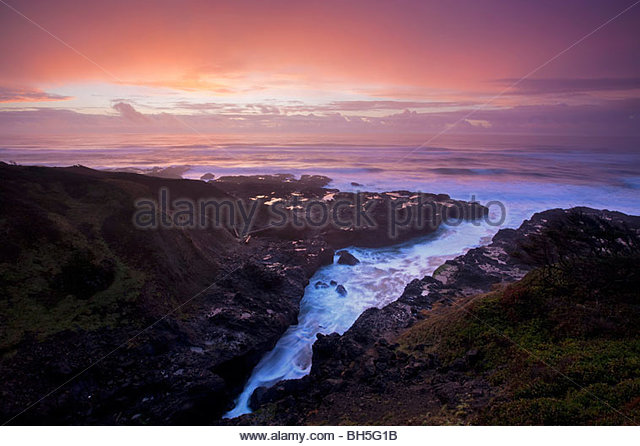 The Pacific Ocean reaches several hundred feet inland at Cooks Chasm, a narrow inlet near Yachats, Oregon. - Stock Image