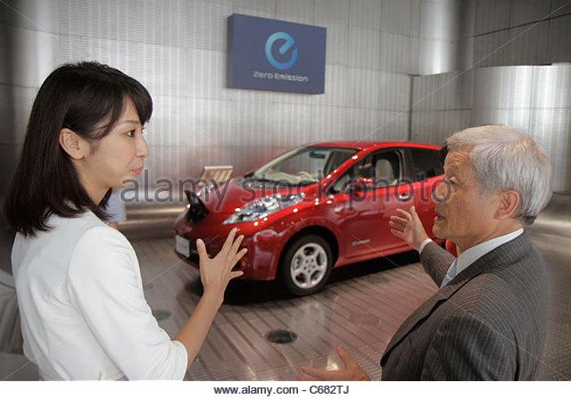 Japan Tokyo Ginza Chuo & Hamuri Dori Street kanji hiragana katakana characters symbols Nissan Leaf electric - Stock Image