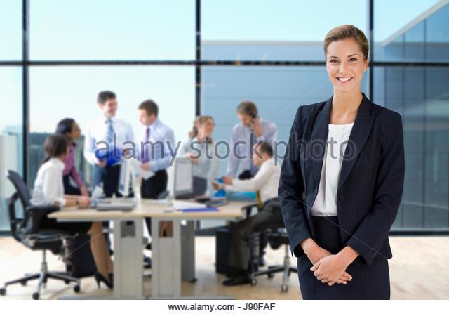 Portrait Of Businesswoman Working In Busy Modern Office - Stock-Bilder